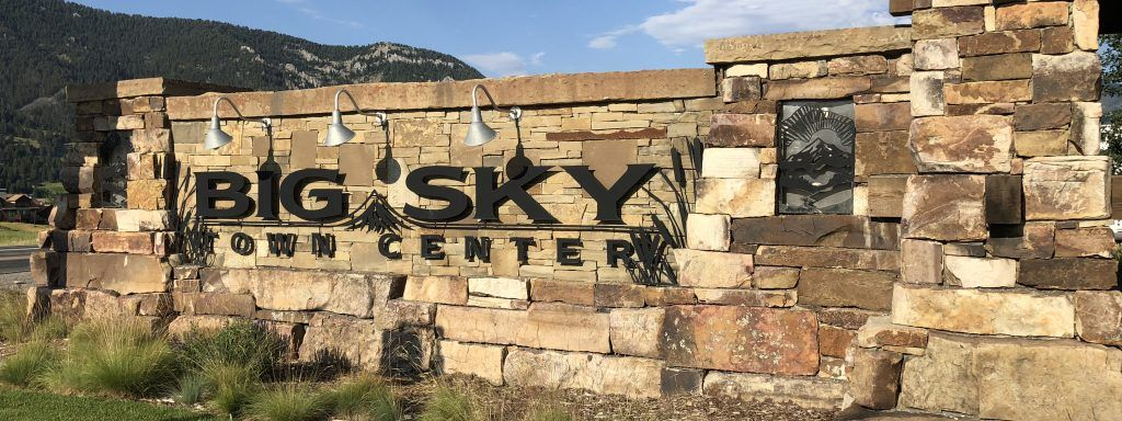 Big Sky Town Center sign with stacked rocks